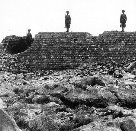 Soldiers of the 36th Sikhs stand on the wall of the ruined building of Saragarhi which was burnt by Pathan tribesmen. All 21 of their colleagues die